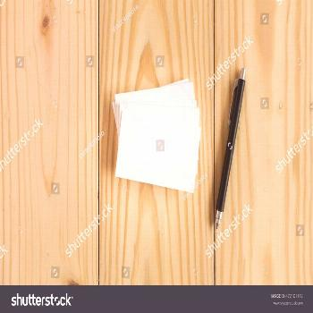 Blank business cards on wooden background ,