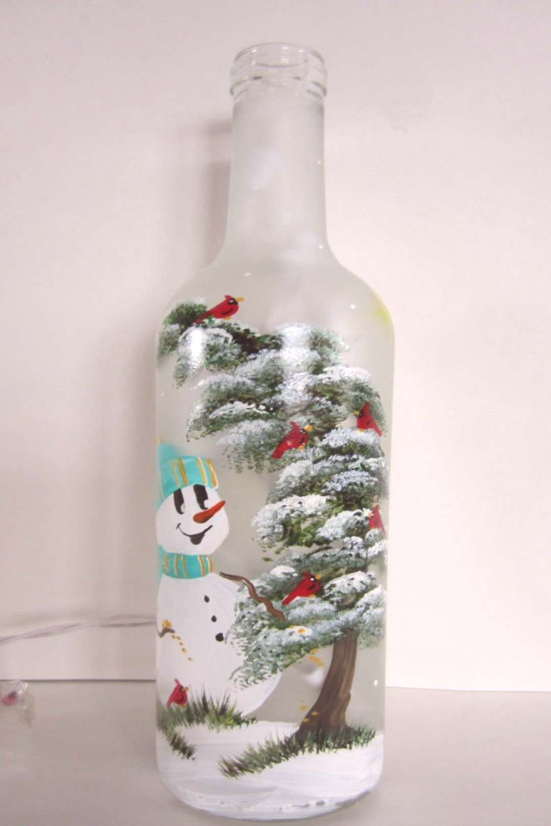 Items similar to Snowman Standing Next to a Whimiscal Winter Tree and Feeding Cardinals *** Frosted